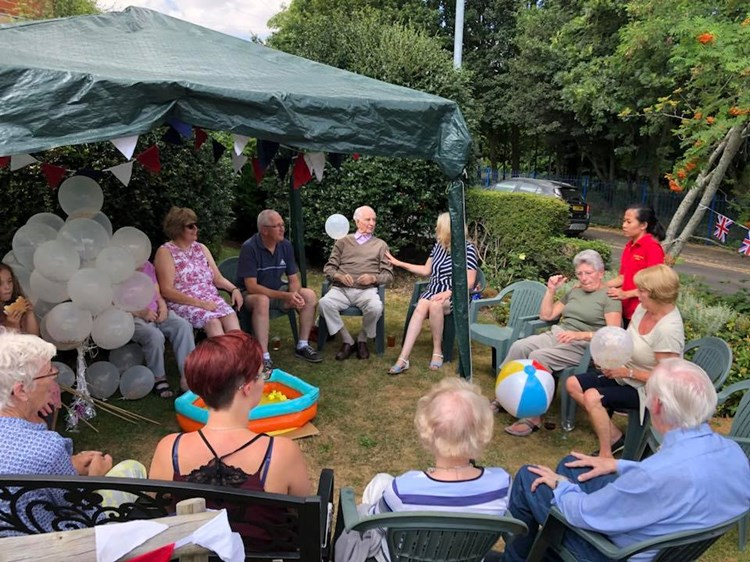 Residents and carers playing